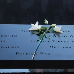 Flowers left for a loved one. On the birthday of each victim, memorial staff place a rose on their name.