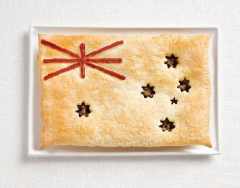 Australia flag made from meat pie and sauce.