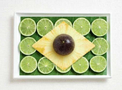 Brazil flag made from banana leaf, limes, pineapple and passion fruit.