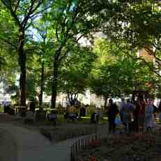St Paul's churchyard -- visitors gather around the Bell of Hope, which hangs above a map of the World Trade Centre site, and is only rung on September 11.