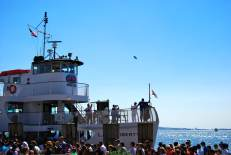 Blimp in the sky, and a ferry tour about to depart to visit the Statue of Liberty.