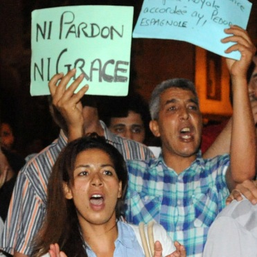 Protesters show their anger during a demonstration on August 2, 2013 in Rabat-Morocco to protest the release of a Spanish paedophile, Daniel Fino Galvan who raped 11 local children was pardoned by the Moroccan King Mohammed VI. AFP PHOTO / FADEL SENNA