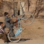 Afghan children play in a street in Herat, on January 14, 2013. (Aref Karimi/AFP/Getty Images)