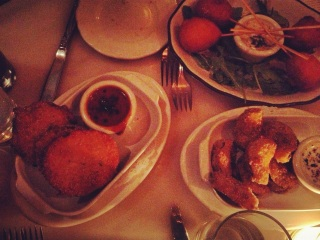 My first ever, and best, experience with Fried Green Tomatoes; and by candlelight (left; mini corn dogs at top, and fried pickles at bottom).
