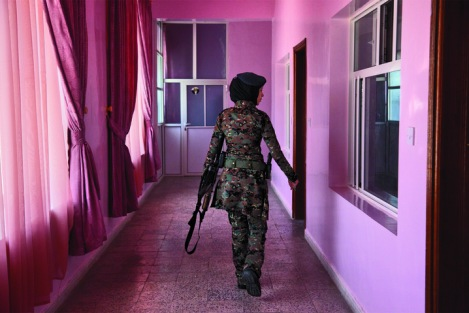 A lieutenant in the elite female counter-terrorism unit patrols the women's barracks, Sanaa, Yemen. By Stephanie Sinclair.