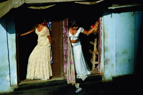 Prostitutes display themselves on a Mumbai street. By Jodi Cobb.