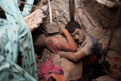 "Of this photo, the photographer Taslima Akhter told TIME magazine: ""Around 2am, I found a couple embracing each other in the rubble. I felt like I knew them. Every time I look back to this photo, I feel uncomfortable. It haunts me. It's as if they are saying, we are not a number, not only cheap labour and cheap lives. We are human beings like you'"". Taken in Savar, near Dhaka, Bangladesh."