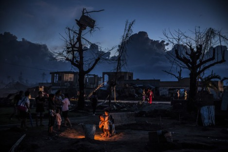 Family gathers around a grave, in Leyte, Philippines, of a relative killed when Typhoon Haiyan struck their home. Typhoon Haiyan which ripped through Philippines has been described as one of the most powerful typhoons ever to hit land, leaving thousands dead and hundreds of thousands homeless. (By Dan Kitwood/Getty Images)