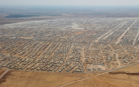 The scale of the sprawling Zaatari refugee camp in Jordan can only begin to be understood from above. On 31 December, the population of the camp was more than 124,000. Currently, there are almost 2.3 million Syrian refugees registered with the United Nations while their country deals with a civil war. (By Mandel Ngan/AFP/Getty)