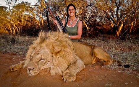 There is something most grotesque about this photo, and it is difficult to look away. The proud, beaming smile, as she clutches weapons. And there are plenty more zebras, bears and alligators where this one came from. Michele Bachman and lion, South Africa (Photographer unknown).