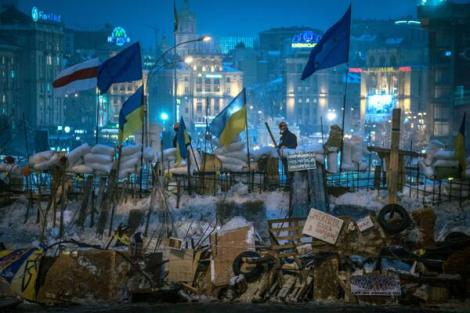 Ukrainian and EU flags fly over newly-erected barricades, Independence Square, Kiev (S.Ponomarev/NYT/ Redux)