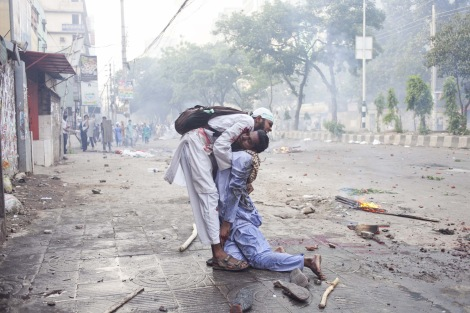 An activist tries to take another severely injured activist to the hospital, Dhaka, Bangladesh. Two people who have been fighting for what they believe in, then one has to fight for one seemingly fighting for his life. There is an intimacy and rawness here that is rarely captured. (By Atish Saha/Demotix/Corbis)
