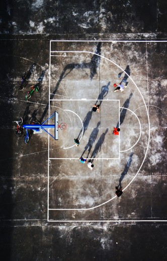 A group of men play basketball on the court. Zhuhai, China.