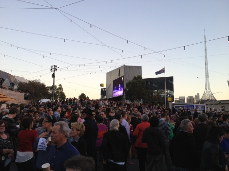 The crowd arrives in Federation Square, Melbourne.