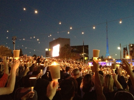 Candles raised in memory of Reza.
