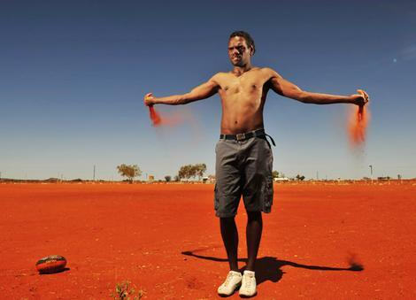 Then-AFL player Liam Jurrah on home town football oval, Yuendumu, Northern Territory, 2009; by Jason South