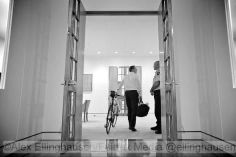 16 Sep 2013: PM-elect Tony Abbott wheels his bicycle into new office; by Alex Ellinghausen