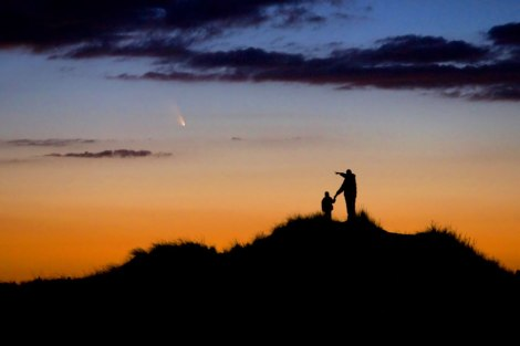 Father and Son Observe Comet PanSTARRS A father and his young son watch the evening display of Comet PanSTARRS on First Encounter Beach, Eastham, Massachusetts, USA. The photographer had spent weeks preparing the shoot to capture the comet, which will not be seen again for over 100,000 years, in order to foster his son's interest in astronomy. Picture: © Chris Cook (USA)