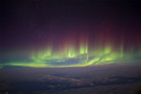 In-flight Entertainment Resplendent aurora seen from the window of a transatlantic flight between London and New York in February 2014. The photographer balanced his camera on his backpack to capture this image of the greatest natural light show on earth from a rare perspective. Picture: © Paul Williams (UK)