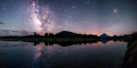 Oxbow Bend Reflections The Milky Way reflected in the Snake River at the famous Oxbow Bend in Grand Teton National Park. The galaxy is poised just above the horizon mimicking a glowing cloud. Picture: © David Kingham (USA)