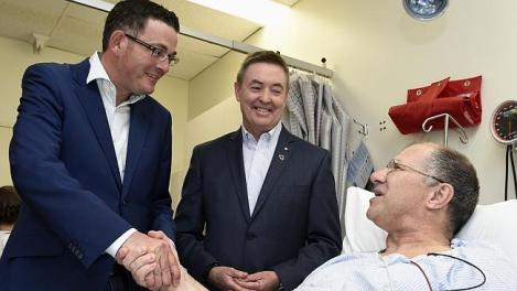 Victorian Opposition Leader Daniel Andrews and Monash Heart director Professor Ian Meredith meet cardiac patient Michael Vanswedan at Monash Medical Centre in Clayton. (Photo: Andy Brownbill/Herald Sun)