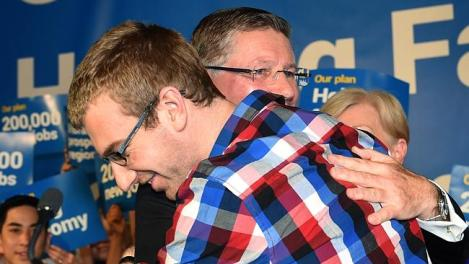 Premier Denis Napthine embraces son Tom at the end of his speech at today's Liberal Party state election campaign launch. (Photo: Mike Keating/Herald Sun)