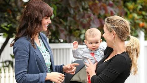 Liberal Candidate for Albert Park, Shannon Eeles chats with local resident Stephanie Condon and her son Austin, 6 months. (Mark Stewart/Herald Sun)