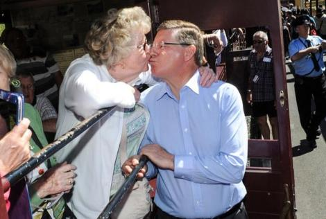 Up close & personal. Premier Denis Napthine receives a kiss from UK tourist Mary @ Puffing Billy (Via The Age Photography Twitter)