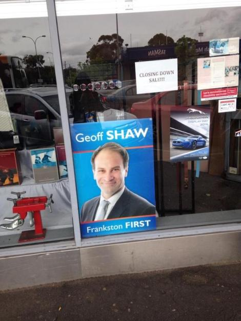 Closing down sale sign above Geoff Shaw poster (Via Henrietta Cook Twitter)