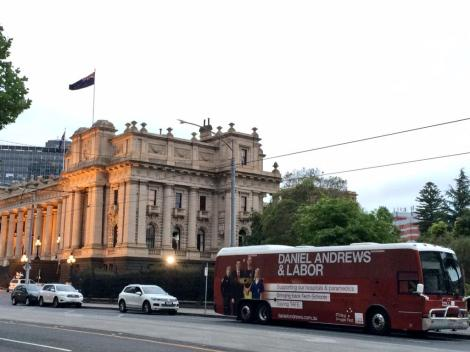 Parliament House big red bus sunrise.(Via Victorian Labor Twitter)