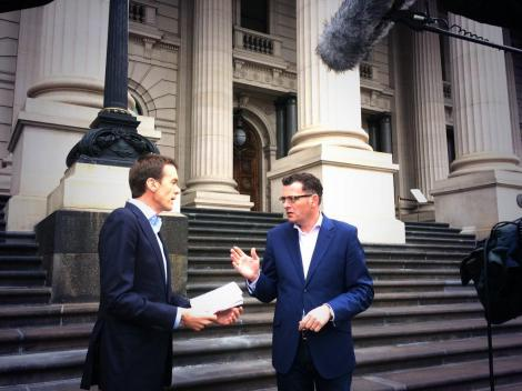 Ready to cross to Breakfast News - Daniel Andrews MP with M Rowland on Spring St steps (Via Victorian Labor Twitter)