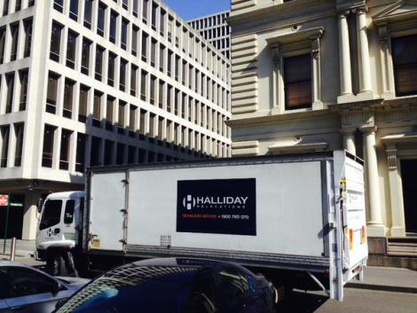 Removal trucks arrive at Treasury Place. (Via David Woiwod Twitter)