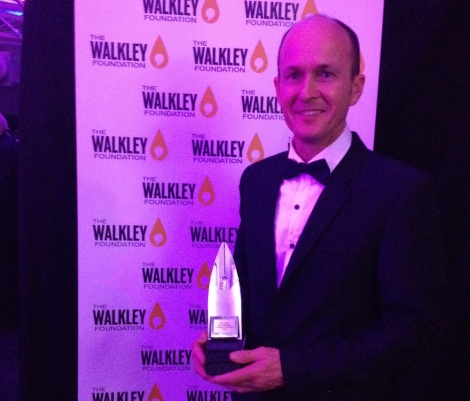 4 December: Andrew Greste  proudly shows off his brother's Walkley Award (Image via freepetergreste.org)