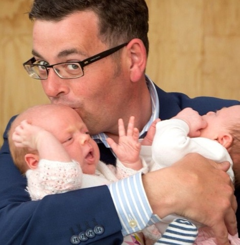 Labor Candidate Daniel Andrews holding 8 week old twins Farrah and Evelyn Stewart of Northcote during a door stop at My Midwives in Brunswick (Photo: Mark Dadswell via Herald Sun Instagram)