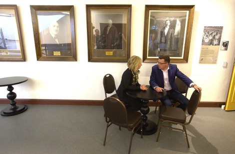 Labor leader Daniel Andrews talks to his wife before addressing Victorian Firefighters at the Collingwood Town Hall. (Photo: Jason South/The Age)
