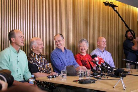 Peter Greste smiles at his father at a press conference in Brisbane (Giulio Saggin/ABC Australia)