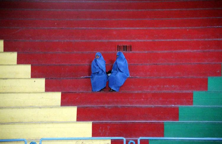 Afghan women watch girls compete in a Taekwon-Do match in Herat (Aref Karimi/AFP/Getty Images)