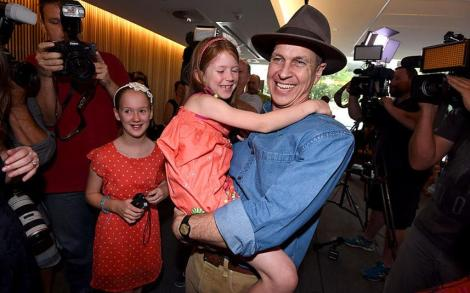 Peter Greste holds niece Sophie after press conference in Brisbane, Australia. (Dan Peled/EPA)