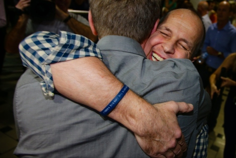 Peter Greste embraces a friend upon his arrival at Brisbane airport (P.Hamilton/Getty)