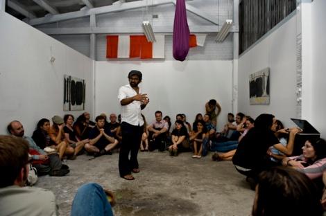 Desh speaking at an arts event Gishiki 25, in February 2012 (Photo: Ondru Arts)