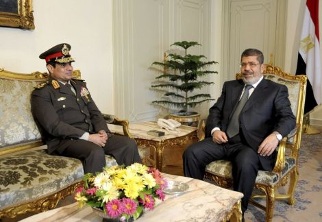 Egyptian Minister of Defense, Lt. Gen. Abdel-Fattah el-Sissi, left, meets with Egyptian President Mohammed Morsi at the presidential headquarters in Cairo, Egypt, February 2013 (photo credit: AP/Mohammed Abd El Moaty, Egyptian Presidency, File)