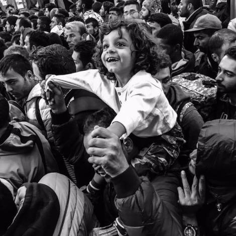 Children can still find moments of joy in all this chaos at Keleti train station. (Photo: Patrick Witty for TIME Magazine)
