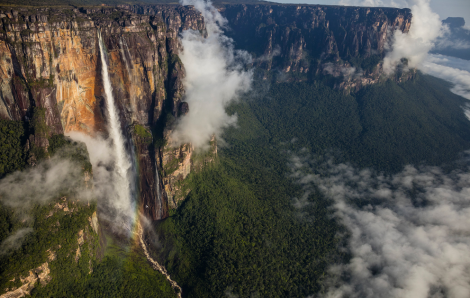 Angel Falls rushing down the side of the Auyán tepui. Flying near the bottom is a Cessna 206, piloted by Jhony Jimenez, a local aviator. (Photo: George Steinmetz)