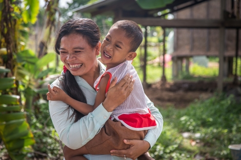 Disability worker Phearom with six-year old Vai Vin. (Photo: Anna Betts/OIC: The Cambodia Project)