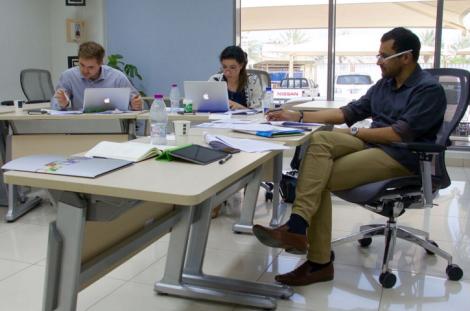 Zac Schroedl (left) and Scherry Bloul (middle) in a workshop with Al Jazeera presenter Kamahal Santamaria.