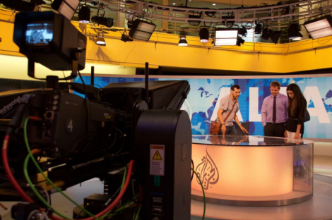 Al Jazeera presenter Kamahl Santamaria takes Zac Schroedl (middle) and Scherry Bloul (right) on a tour of the Al Jazeera studios in the organisation's headquarters in Doha, Qatar.