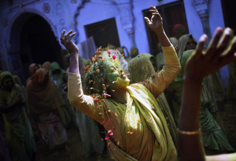 Widow dances as she takes part in the Holi celebrations at a widows' ashram, India (Reuters)