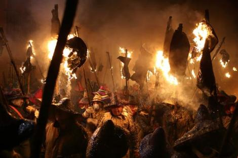 Villagers take part in the Civic Procession of El Vitor in the town of Mayorga, Spain (Jose Vicente/AP)