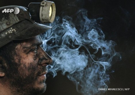 A miner at the end of his last shift at the closure of the Petrila coal mine, Romania (AFP)