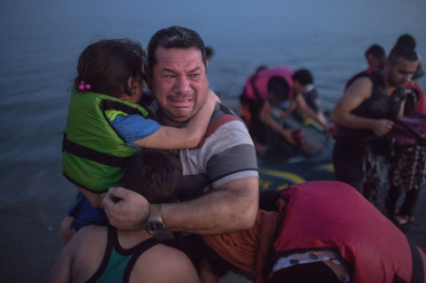Laith Majid, an Iraqi, broke out in tears of joy, holding his son and daughter, after they arrived safely in Kos on a flimsy rubber boat. Daniel Etter for The New York Times